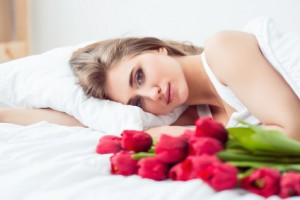 Pleasant charming girl lying in bed